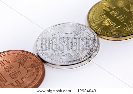 Three Bitcoins On White Backround