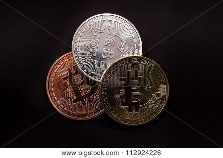 Three Bitcoins With Dollars On Black Backround