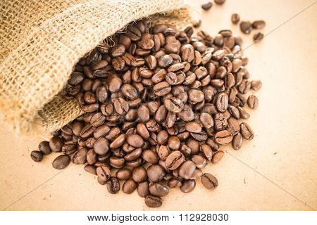 Coffee Roasted Bean In The Sack On Wooden Background