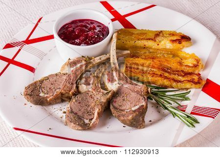 Rack Of Lamb With Cranberry Sauce And Fried Banan