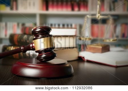 Law Concept With Gavel And Scale In Background