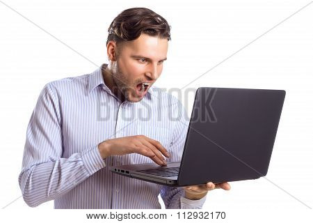 Handsome Surprised Businessman Skreaming At Laptop