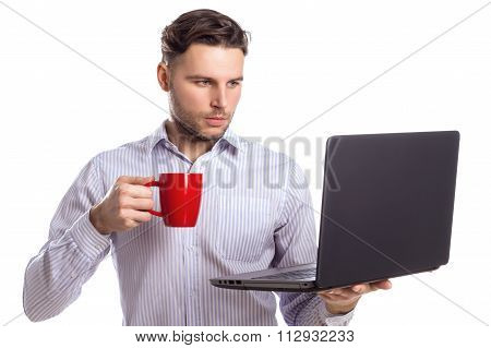 Handsome Businessman Holding Red Cup And Looking At Laptop Isola