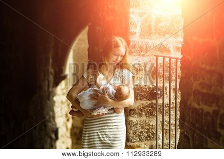 Young Woman Holding Child