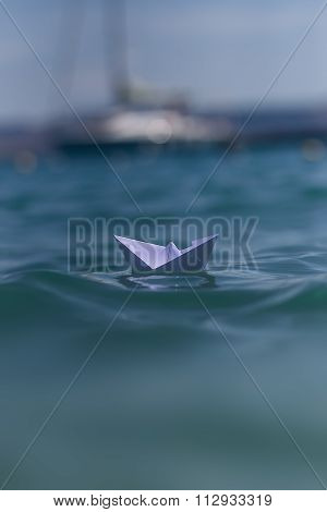Origami Boat Riding On Waves