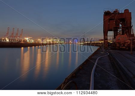 Container terminal Tollerort in Hamburg at night in HDR