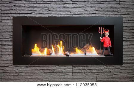 Little Devil In The Modern Fireplace.