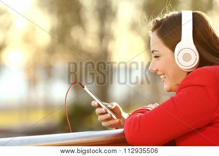 Lady Listening Music From Smart Phone