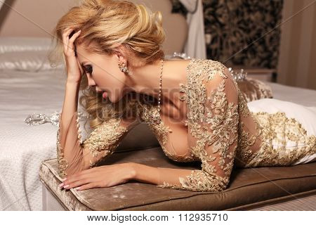 Sexy Woman With Long Blond Hair Wears Luxurios Lace Wedding Dress And Bijou