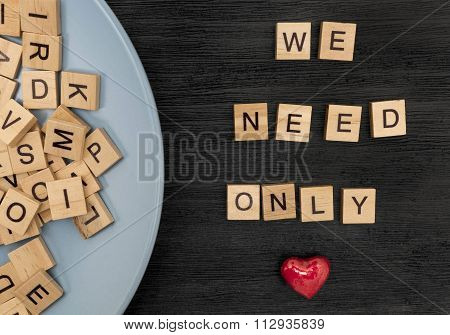Wooden Letters Spelling We Need Only Love