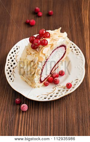 Dessert Roll With Delicious Cream And Red Currant