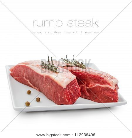 Fresh Rump Steaks With Rosemary On Plate