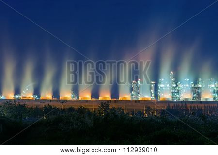 Steaming Cooling Tower Of Oil Refinery Plant.