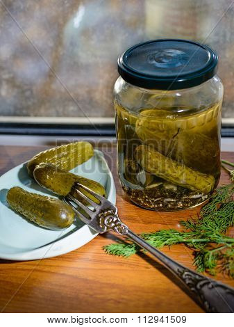 Pickled Cucumbers In Glass Jar.