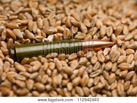 Kalashnikov Cartridge Over Grain Background