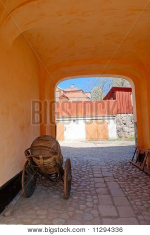 Arch With A Cart And A Barrel