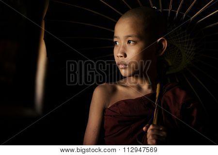 Portrait of young novice monks walking thru a Buddhist temple, Bagan, Myanmar.