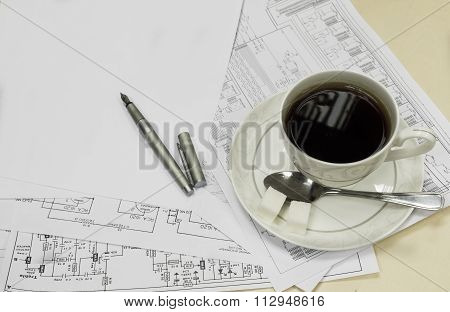 Cup Of Coffee With Papers And Nib