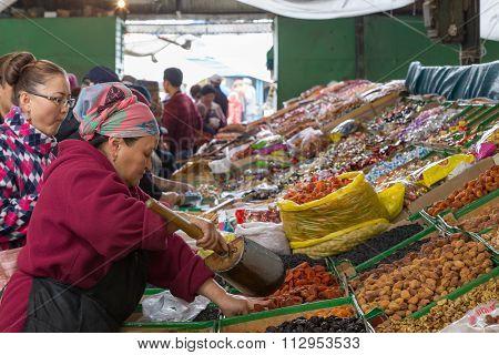Dried fruits vendor at Osh Bazaar