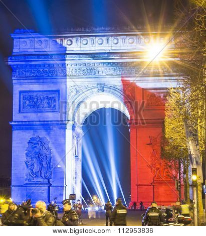 The Triumphal Arch Lit Up With The Colors Of French National  Flag.