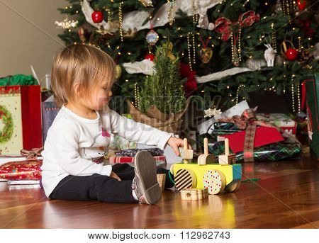 Young Caucasian Baby Girl Playing With Presents At Xmas