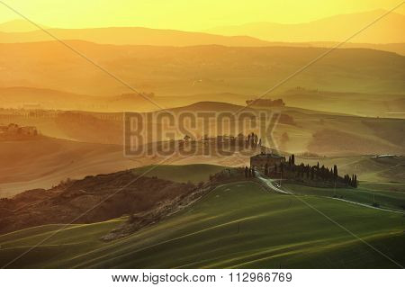 Tuscany Spring, Rolling Hills On Misty Sunset. Rural Landscape. Green Fields And Farmlands. Italy
