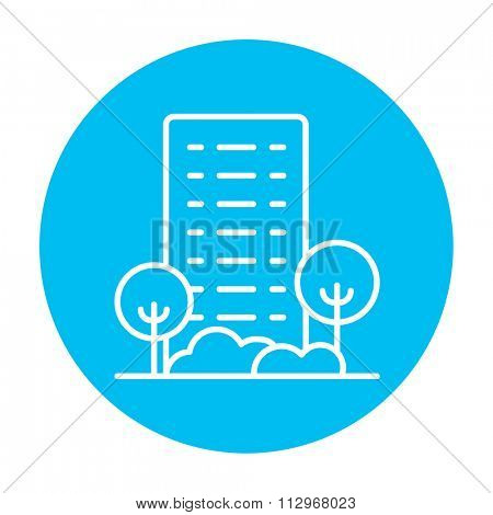 Residential building with trees line icon for web, mobile and infographics. Vector white icon on the light blue circle isolated on white background.