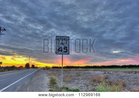 Cirrocumulus clouds over posted road sign.
