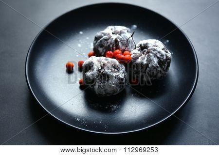 Chocolate balls with ash berry on table