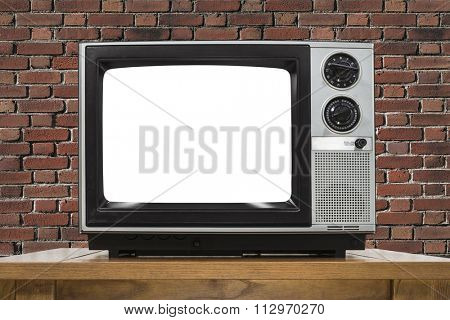 Analog television with brick wall and cut out screen.