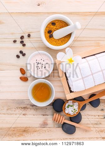 Natural Spa Ingredients Sea Salt ,coffee Beans ,honey , Almonds ,spa Stones And White Mortar On Wood