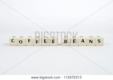 COFFEE BEANS white cube text on white background AND coffee beans background
