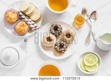 Lemon Green Tea And Sweets - Banana Muffins, Cookies With Caramel And Nuts, Donuts With Chocolate An