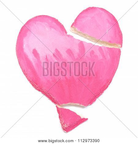 Close Up Of A Salt Mass Broken Heart On White Background