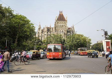 MUMBAI, INDIA - OCTOBER 9, 2015: Unidentified people by the Oriental buildings in Mumbai India. Building was built at 18850 and initially housed the Cathedral School.
