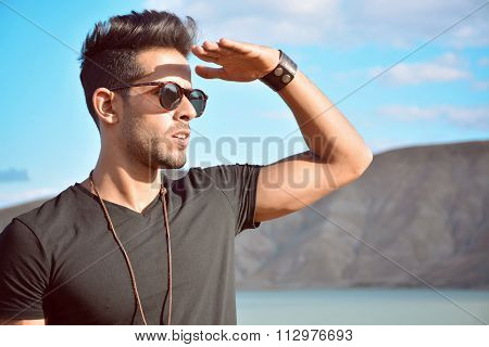 Attractive Man With Glasses Hide The Sun With His Hand