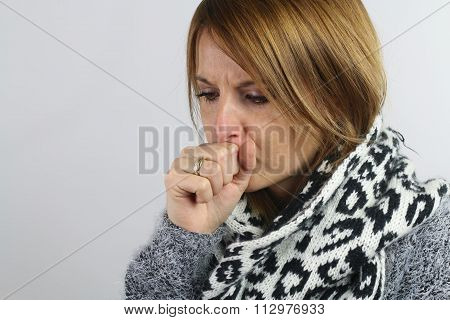 blonde woman coughing