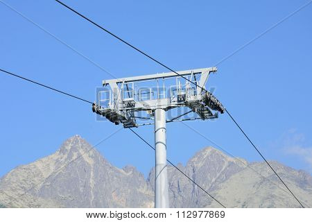 Chair lift mechanism with mountain in background