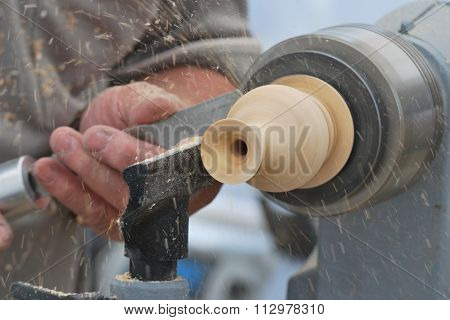 Preparing wood on lathe