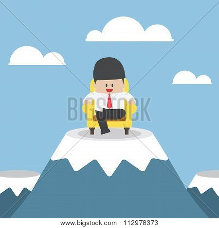 Successful Businessman Is Sitting On Sofa At Mountain Peak