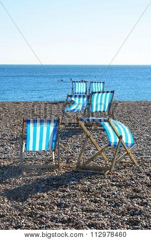 Deckchairs on shingle beach