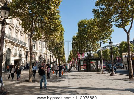 PARIS, FRANCE - SEPTEMBER 9, 2014: The Champs-Elysees the most famous avenue of Paris and is full of stores cafes and restaurants. Paris France