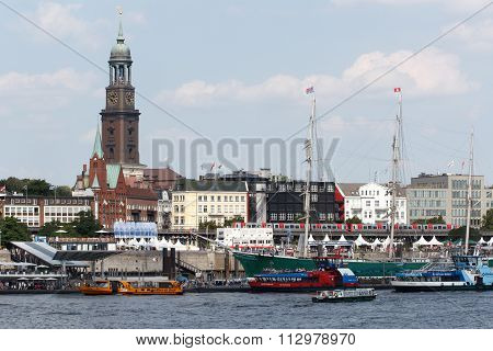 View over the Elbe towards the St. Pauli Piers with St. Michael's Church in Hamburg