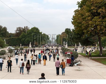 PARIS, FRANCE - SEPTEMBER 10, 2014: Paris - Local and Tourist in famous Tuileries garden. Tuileries Garden (Jardin des Tuileries) is a public garden located between the Louvre  and the Place de la Concorde. France.