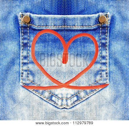Blue Jeans With Pocket And Red Heart Closeup