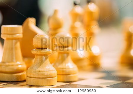 Old Chess Standing On Chessboard
