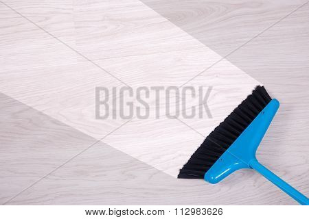 Cleaning Concept - Blue Broom Sweeping Floor