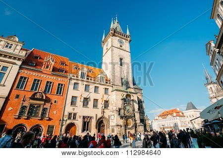 People walking near astronomical clock in Prague, Czech Republic
