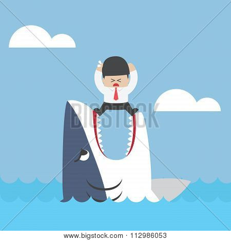 Businessman Standing On Jaws Of Shark