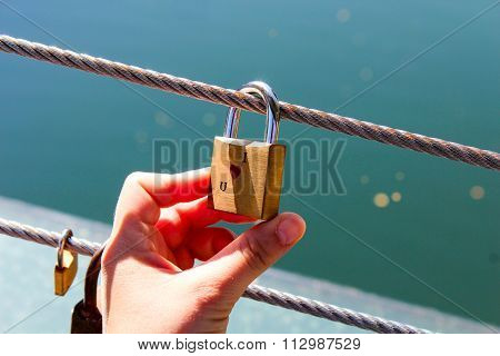 Love Padlock Hanging On A Wire